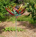 Tresco Large Garden Wind Sculpture Spinner with Solar Light Crackled Globe